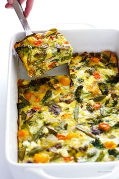 This Spring Vegetable Egg Casserole is the perfect way to highlight all of your favorite seasonal veggies. And when paired with zesty feta cheese, and baked up into an easy casserole, it's the perfect make-ahead dish to serve a crowd. Easy Egg Casserole, Asparagus Casserole, Vegtable Casserole Recipes, Egg And Veggie Casserole, Mixed Vegetable Casserole, Brocolli Casserole, Veggie Egg Bake, Vegetable Bake, Casserole Ideas
