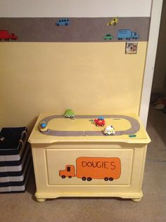 Painted old chest with van and cars on each end. Top is a race track for toy cars.