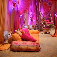 Just imagine one bed, queen sized for the bride, undergoing the mehendi celebration, where we can see the assortment of quirky sized pillows and neat floral headstand too.