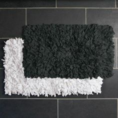 Recycled Jersey Bath Mat | west elm OR DIY your own using a stay-put rug liner and old tshirts tied in the holes