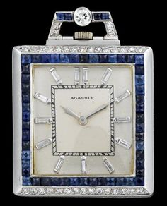 Platinum, sapphire and diamond pocket watch, Agassiz   art deco   Square case, silver tone face, baguette cut diamond dial, face sign by the maker, bezel framed by French cut sapphires and petite round cut diamonds. Mechanical movement signed by the maker, displaying movement serial no. 307590. Diamond and sapphire set bail. Accompanied by original box.