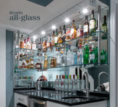 Hanging stack bar with glass shelves and mirror wall, liquor bar, home bar design ideas.
