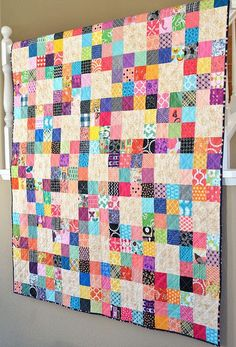 I like the way she used a neutral fabric to pull the scrappy blocks together. Brilliant!