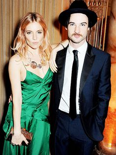 Sienna Miller and beau Tom Sturridge dress to impress while attending the British Fashion Awards in London on Monday... Super cool