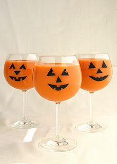 DIY Pumpkin Cocktail Glasses via superpunch: The link for the template seems to be gone, but it would be easy enough to do with electrician's tape.
