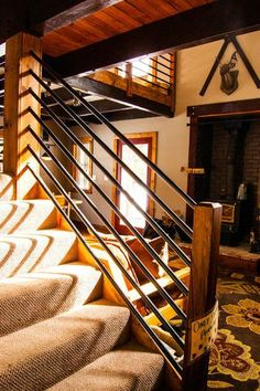 Stair railing constructed of painted galvanized gas pipe by J. Tight Interiors.