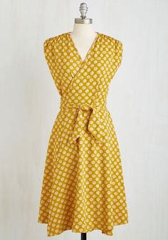 Here Comes the Sunrise Dress. Welcome some sunshine into your ensemble by donning this wrap dress by modern, California-based designer, Effie's Heart. #yellow #modcloth