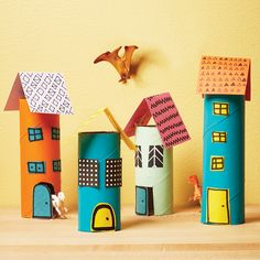 A pretend play for hours of endless fun! This cardboard village is easy to make!
