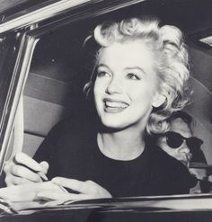My favorite pictures of Marilyn are the ones where she seems caught off guard, smiling a huge smile
