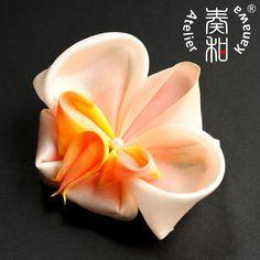 Luxuriously Hand Dyed Large Phalaenopsis Orchid Tsumami Kanzashi Alligator Clip. $44.99, via Etsy.