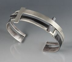 T Square Cuff by Hilary Hachey. Clean lines and geometric forms define a hand-fabricated sterling silver cuff that contrasts matte silver and *oxidized:oxidize* finishes. Available for wrist sizes small (6