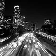 Black and white picture of the Los Angeles Skyline at night along the Harbor Freeway.