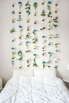 A flower wall is a great DIY dorm room decor idea!