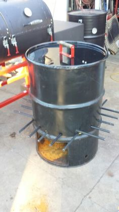 55 gallon burn barrel.  Add logs and embers come out the bottom.
