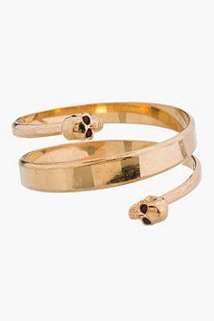 Alexander McQueen Gold Spiral Twin Skull Bracelet for women | SSENSE