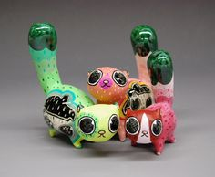 humptydumptyunbroken:  Samantha Bachman  ceramic cats.
