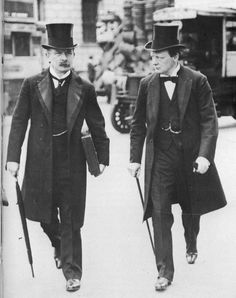"""British formal dress: David Lloyd George (left) and Winston Churchill wear frock coats and top hats, 1907.    The """"Terrible Twins"""" Winston Churchill and David Lloyd George in 1907 during the peak of their """"radical phase"""" as social reformers."""
