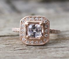 Hey, I found this really awesome Etsy listing at http://www.etsy.com/listing/128084595/cushion-white-sapphire-halo-diamond-ring