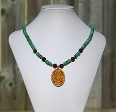 Turquoise and poppy jasper necklace with tagua nut pendant by Drakestail, $40.00