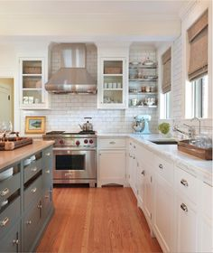 White cabinets with silver clamshell pulls & different color cabinet on island