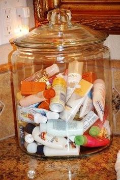 Collect hotel shampoos, conditioners, lotions, etc and put them in a glass container in the spare bathroom for guests.