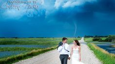 Photographer captures funnel behind them on their big day