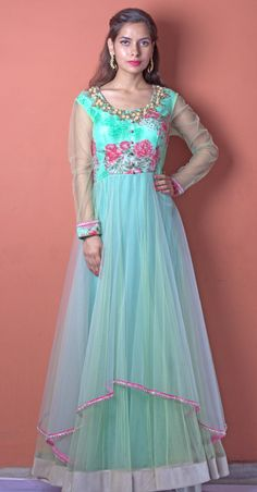 Floral print detailing in a outfit never goes out of fashion. This mint green high-low gown is the most suitable for a wedding season. This outfit can be worn for a function like MEHENDI in which you can dance and twirl around gorgeously.