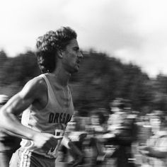 Black and white photo of University of Oregon cross country runner Ken Martin running the track at the 1979 Northern Division Championships held at Lane Community College. ©University of Oregon Libraries - Special Collections and University Archives
