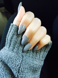 gray almond stiletto nails.