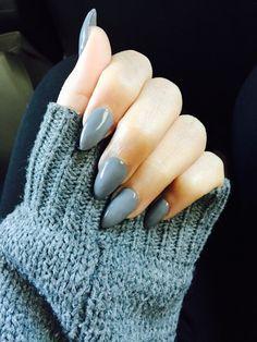 gray almond stiletto nails.