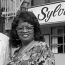 """If you are like many people, you enjoy some soul food from time to time. You might also find it interesting to know that just like the """"Queen of Soul,"""" there was the """"Queen of Soul Food."""" Before Pattie Labelle was baking sweet potato pies in her kitchen, Sylvia Woods was hard at work cooking […]  Th...If you are like many people, you enjoy some soul food from time to time. You might also find it interesting to know that just like the """"Queen of Soul,"""" there was the """"Queen of Soul Food.""""…"""