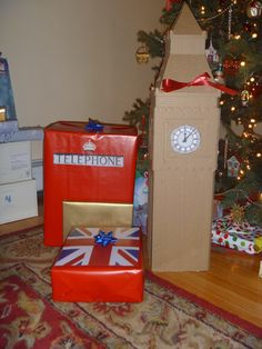 HE IS CRAFTY! Another themed Christmas (it's our thing!)... This was Christmas 2010.. the theme was Christmas in London! He took a cardboard box and made it into Big Ben..he made the face and all the details. In the top where the bow was affixed, the top opened, and hanging inside 'the dials' there was a piece of jewelry.. then the rest was hollow and inside was a giant glass vase I wanted for corks! Then the rest were wrapped in British themed paper that he made!