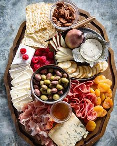 I'm keeping the appetizers simple and easy this Christmas with this Cheese and Meat Board. It only takes a few minutes to put together and makes all meat and cheese lovers happy.
