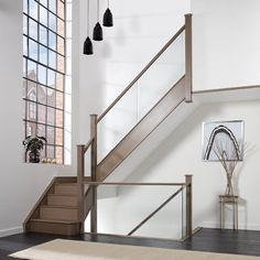 This stunning dusted oak inline glass staircase is handcrafted from the finest materials and features integrated lighting.Request your brochure today. Stair Banister, Timber Staircase, Painted Staircases, House Staircase, Banisters, Staircase Design, Railings, Railing Design, Balustrade Design