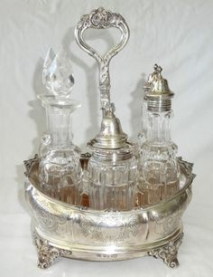 Up for sale from a recent client in Honolulu this 1873 UK London Sterling Silver and crystal cruet set by William Evans. It was originally a set of 7 pieces but two crystal bottles are missing.