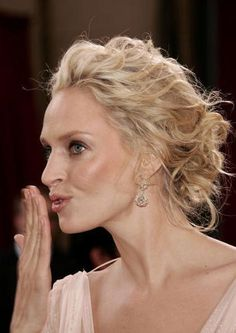 Severely in love with Uma Thurman's hair in this picture.