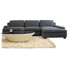 Sectional sofa with twill upholstery.          Product: 2 Piece sectional sofa   Construction Material: Hardwood, high...