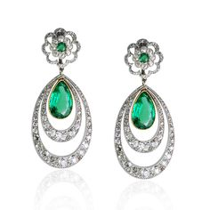 Pair of Edwardian emerald and diamond ear-pendants, each florette cluster top suspending two graduated diamond eliptical hoops containing a single pear-shaped emerald drop, mounted in silver and gold, in fitted case