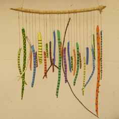 wind chime made out of painted wood sticks