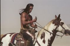 Native American on a paint horse.