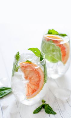 A simple two-ingredient cocktail gets a major upgrade with fresh grapefruit juice and basil. Perfectly refreshing for summer, this cocktail will have everyone convinced you're a cocktail connoisseur.   #gin #cocktail
