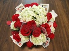 centerpiece idea: silk flowers and cards mixed together