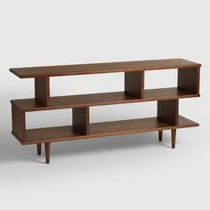 Featuring six roomy compartments, our bookcase offers ample storage space for books, framed photos and keepsakes, with plenty of mid-century-inspired style to spare. A rich dark brown walnut stain highlights the wood construction of this shelf that doubles as a console table or media stand.
