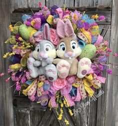 Easter Wreath, Spring Wreath, Bunny Wreath, Thumper Wreath, Spring Wreath, Deco Mesh Easter Wreath, Deluxe Easter Wreath Happy Easter to You! What a way to greet the season- our beloved characters from Bambi have made an appearance! Its Thumper & Miss Bunny!  This wreath is lush and full of detail! You are looking at the Cutest Wreath- I am sure- its our favorite characters we adore- Thumper & Miss Bunny! Deluxe & Gorgeous is an understatement- beautiful florals, colorful ...