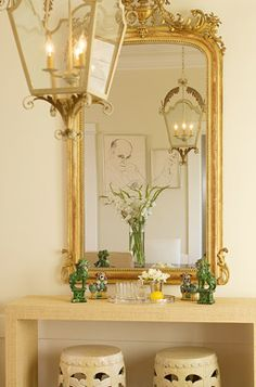 stunning gold mirror and lighting