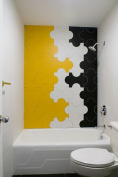 Splendor in the Bath. Yellow, black, and white Gio Ponti wall tiles created for the 1960 Milan Triennale by Marazzi Designs. Interior Designer: Young Huh.