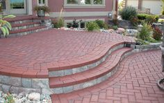 I like this raised patio, though the whole thing wouldn't have to be made out of the brick.