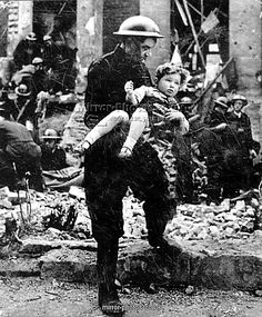 Fireman and rescued girl during Clydebank Blitz, March 1941