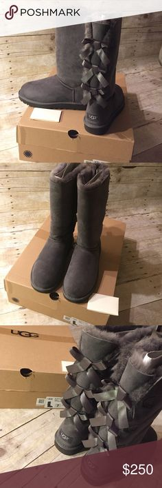 Ugg Tall Bailey Bow • Grey % Authentic Ugg Bailey Bow • Grey • Tall • Size 7 • brand new in box. Comes with all original packaging. Purchased at Victoria Secret online. Still have the receipt and can verify authenticity. UGG Shoes