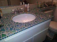 Sea glass and shells mixed media mosaic bathroom countertop by Marianas Mosaics